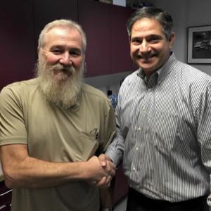 John Schank Lynden Hero Driver John Schank (Resembling a buff Santa) with Lynden Transport President Paul Grimaldi.